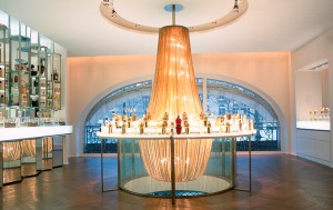 Gold-beaded chandelier encircling the fragrance display in the 2005 renovation of the Guerlain's flagship Paris boutique. Source: Interior Design.net