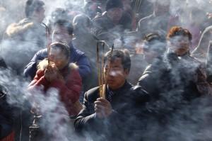 Beijing incense burning on Buddha's birthday. Photo: Jason Lee/Reuters via the WSJ