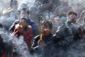 Beijing incense burning on Buddha's birthday. Photo: Jason Lee/Reuters via the WSJ