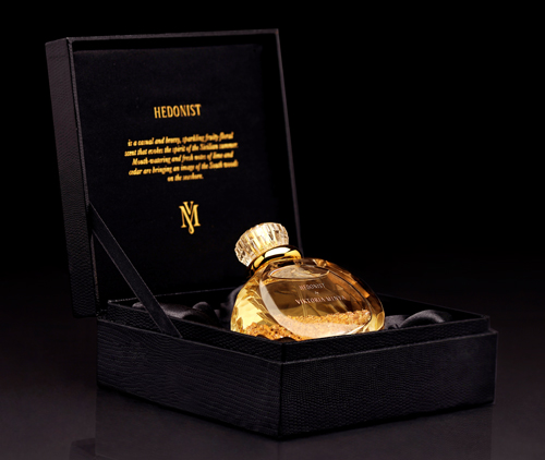 "Hedonist in its handmade wooden box that is ""fashioned to capture the sleek look and feel of snakeskin leather."""