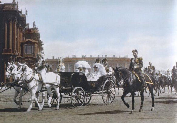 Photo of Tsar Nicholas II accompanying Tsarina Alexandra and Dowager Empress Maria Feodorovn, at the Winter Palace Photograph circa 1901 by Burton Holmes. Source: Angelfire.com