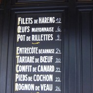 Menu on the wall outside a bistro.