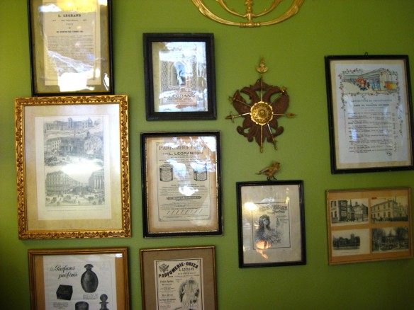Some of the original 1900s posters and adverts for Oriza fragrances, now framed and under glass.