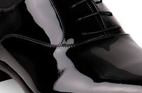 Black, patent leather. Source: ferragamo.com
